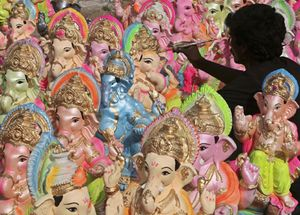 An artisan paints a statue of Ganesha on a roadside in the western Indian city of Ahmedabad.