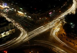 Traffic moves at busy intersection in New Delhi