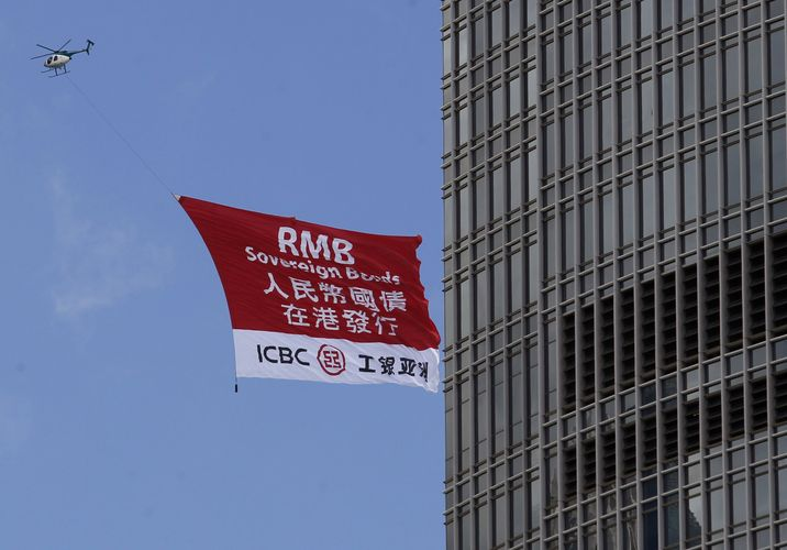 A helicopter carries an ICBC advertisement banner