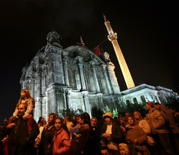 Residents gather in front of Ortakoy Mosque