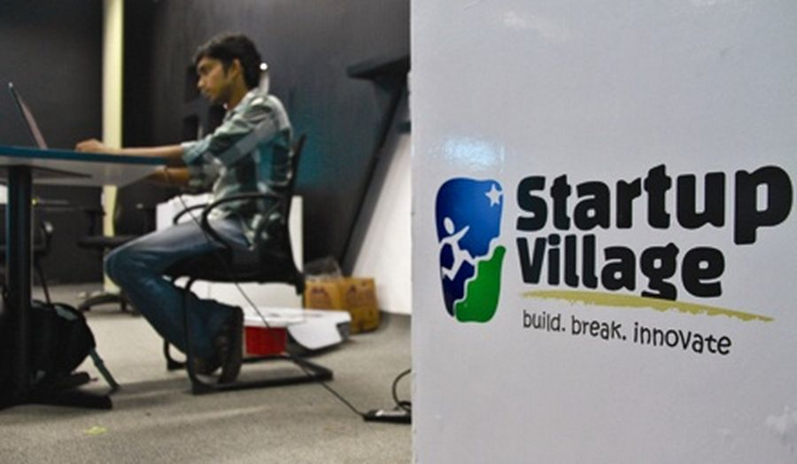 An employee works on his laptop at the Start-up Village in Kinfra High Tech Park in the southern Indian city of Kochi.