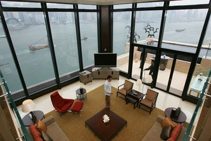 A top view of the living room of the presidential suite in the InterContinental Hong Kong Hotel with a window view of the Victoria Harbour.