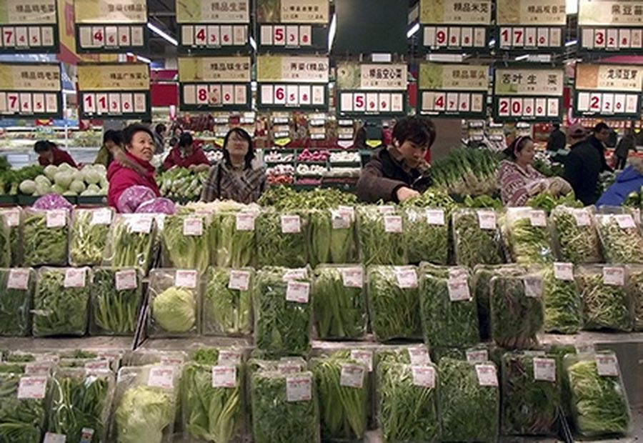 Customers select vegetables at a supermarket in Changzhou, Jiangsu province.