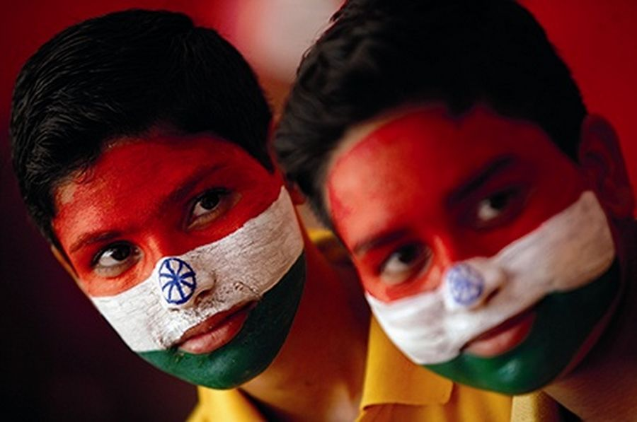 School boys with their faces painted in the colours of India's national flag, take part in India's Independence Day celebrations in Jammu.