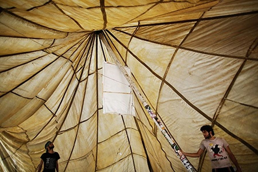 Supporters of Nawaz Sharif's Pakistan Muslim League - Nawaz (PML-N) dismantle a huge tent at one of party's election headquarters in Lahore.